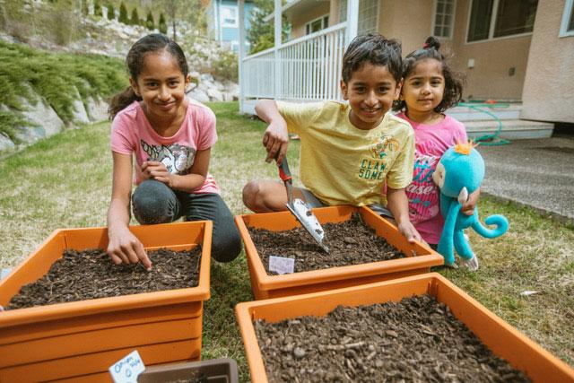 Children in Yard in Trail